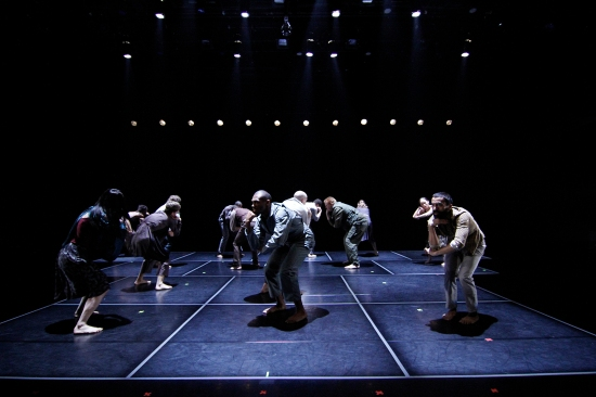 """Dactors"" on the Memorial Hall stage for the premiere of A RITE. Photo: Paul B. Goode."