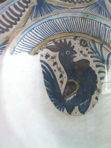 A fragment of 15th c. rooster-decorated Florentine majolica found in the cloister of San Agostino, Pietrasanta, Toscano, Italia, on display in that building which now houses the town's public library, civic museum and Museo dei Bozzetti.