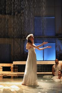Carey Cox in the rain, with Nilan Johnson and Nathaniel P. Claridad, in METAMORPHOSES. Photo: Michal Daniel for PRC.