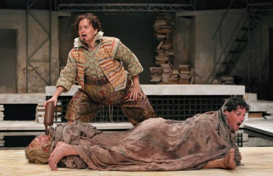 Wonderfully comic Julia Wilson as Stephano, with Jeffrey Blair Cornell's Caliban and John Allore's Trinculo under the blanket, in PRC's THE TEMPEST. Photo: Michal Daniel for PRC.