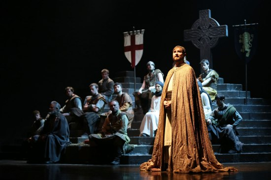 Malcolm crowned near the beginning of DUNSINANE. The National Theatre of Scotland/Royal Shakespeare Company production is at Carolina Performing Art. Photo courtesy of the artists.