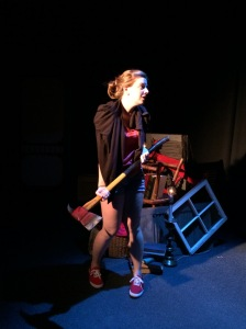 Annie get your axe--there's more than one way to skin a bear. Faye Goodwin as American Annie. Rehearsal photo by Jules Odendahl-James.