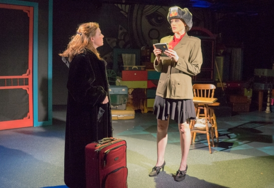Annie the American (Faye Goodwin) is welcomed to Russia by a customs officer (Laurel Ullman) in Manbites Dog's production of THE FAIRYTALE LIVES OF RUSSIAN GIRLS. Photo: Jules Odendahl-James.