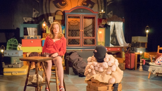 Annie the American (Faye Goodwin) prepares to battle potatoes (Jeanine Brinell Frost) bewitched by Baba Yaga. Note the Pussy Riot-style head covering . Photo: Jules Odendahl-James.